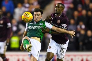 Hibs' Stevie Mallan in action with Hearts midfielder Arnaud Djoum. Picture: SNS Group