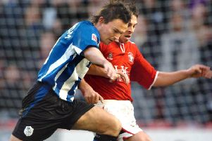 Paul Heckingbottom, in Sheffield Wednesday colours, battles with Barnsley's Michael Chopra in 2005. Pic: Steve Ellis