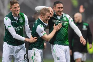 Hibs players celebrate their win over Hearts. Pic: SNS