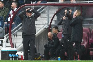 Craig Levein and his coaching staff react after a missed chance during Hearts' defeat to Hibs. Picture: SNS