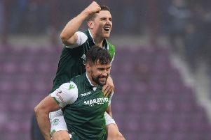 Paul Hanlon and Darren McGregor celebrate Hibs' 2-1 win at Tynecastle