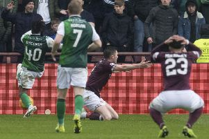 Hearts defender John Souttar appeals for a penalty in the first half