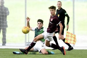 Kane O'Connor challenges Aaron Hickey during an SPFL Reserve Cup tie between Hearts and Hibs. Picture: Lisa Ferguson