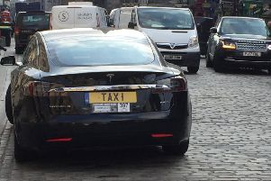 Edinburgh's Most Expensive Private Hire Car?''Tesla (approx �50k) with personlised plate seen in the High Street, Edinburgh