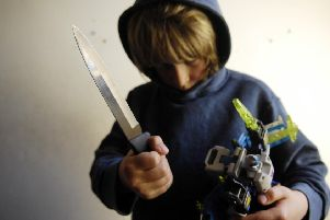 Youth knife crime caused concerns about raising age of criminal responsibility to 16. Picture (posed by model): Phil Wilkinson