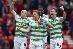 James Forrest, centre, celebrates with his team-mates after giving Celtic the lead. Picture: SNS