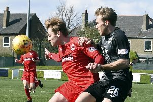 Edinburgh City's Danny Galbraith, right, challenges  Barry Cuddihy. Picture: Lisa Ferguson
