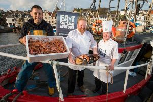 Skipper Michael Bruce with his langoustine catch, with prize winning seafood chefs Craig Millar, and Abbie Clunie.