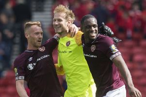 Goalkeeper Zdenek Zlamal celebrates Hearts' semi-final victory with Ollie Bozanic, left, and Uche Ikpeazu. Picture: SNS.