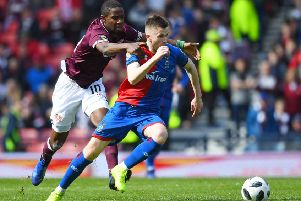 Hearts star Arnaud Djoum, left, battles with with Liam Polworth during the William Hill Scottish Cup semi-final