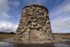 Custodians of Culloden Battlefield may try and secure World Heritage Site status for the historic development to protect it from development. Pictured is the memorial cairn to those who died during the clash between Jacobites and British Government forces on April 16, 1746. PIC: Jane Barlow/TSPL.