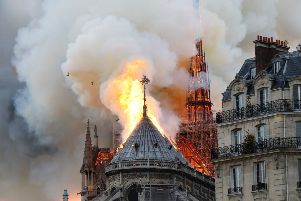 Smoke and flames rise during a fire at the landmark Notre-Dame Cathedral in central Paris on April 15, 2019, potentially involving renovation works being carried out at the site, the fire service said. (Photo by FRANCOIS GUILLOT / AFP)FRANCOIS GUILLOT/AFP/Getty Images
