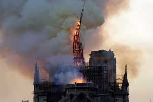 The steeple of the landmark Notre-Dame Cathedral collapses as the cathedral is engulfed in flames. Picture: Getty Images