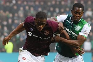 Marvin Bartley (right) battles for the ball with Hearts striker Uche Ikpeazu in the Edinburgh derby. Picture: SNS Group