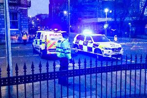 Officers in attendance on Chester Street in the West End following a suspected shooting. Picture: Alasdair Morton