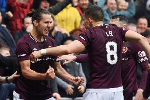Peter Haring (left) has been in fine form for Hearts this season - but his team-mates need to step up in his absence. Picture: SNS Group