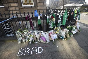Floral tributes and were left near the scene where Bradley Welsh was shot and killed on Wednesday evening on Chester Street. Picture: Greg Macvean