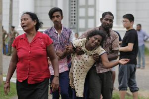 Relatives of a blast victim grieve outside a morgue in Colombo. More than 200 were killed and hundreds more hospitalized with injuries from eight blasts that rocked churches and hotels in and just outside of Sri Lanka's capital on Easter Sunday. Picture: AP/Eranga Jayawardena