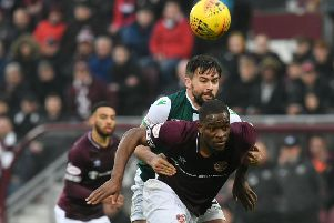 Darren McGregor grapples with Hearts star Uche Ikpeazu