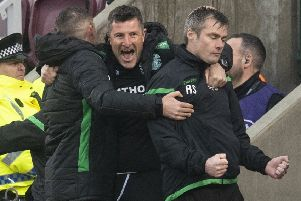 Hibs manager Paul Heckingbottom, first-team coach Grant Murray and assistant manager Robbie Stockdale celebrate Daryl Horgan's goal to make it 2-1 in the derby at Tynecastle