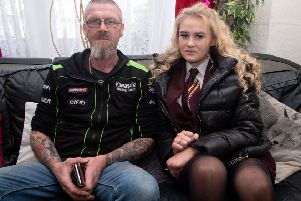 Ian Long with his daughter Kimberley (13) who has been sent home from school after getting her nose pierced. Picture: SWNS