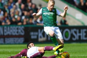 Hibs winger Daryl Horgan is challenged by Sean Clare