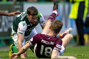 Hibs' Lewis Stevenson and Hearts' Steven MacLean clashed towards the end of last weekend's derby. Pic: SNS