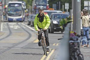 A cyclist heading  East to West on Princes Street, approaching the Lothian Rd junction and the floral tribute. Pic:''' Neil Hanna Photography