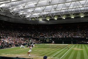If only plans for a Wimbledon-style roof for the Grassmarket had been unveiled along with the rest of the uncosted City Centre Transformation Plan. Picture: AFP/Getty
