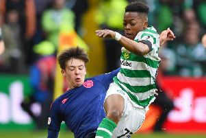 Two 16-year-olds - Hearts' Aaron Hickey and Celtic debutant Karamoko Dembele - in action at Celtic Park.