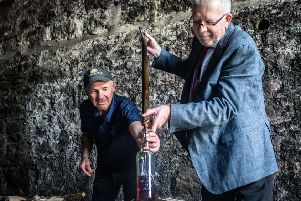Hector McMurchy, assistant distillery manger at Glen Scotia, with Michael Russell MSP. PIC: Contributed.