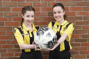 Lauren and Sophie MacDonald both dream of playing for Arsenal when they are older.  Picture: Greg Macvean