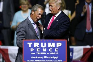 Donald Trump greets Nigel Farage during a campaign rally in Jackson, Mississippi, in 2016 (Picture: Jonathan Bachman/Getty Images)