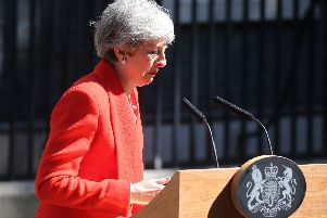 A tearful Theresa May announces her plans to resign. Picture; PA