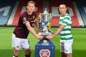 Hearts captain Christophe Berra and Celtic captain Scott Brown face off ahead of the William Hill Scottish Cup Final. Pic: SNS
