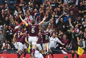 Hearts' players celebrate Ryan Edwards' opener with the fans