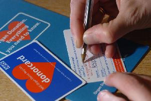 Under current law, donors must opt in for their organs to be donated, with many people carrying a donor card. Picture: JP