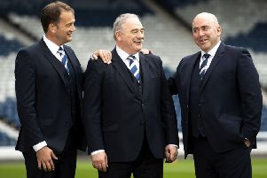 Scottish FA chief executive Ian Maxwell, left, Rod Petrie, the SFA's new president and current Hibs chairman, centre, and Mike Mulraney, the  new vice-president and current Alloa chairman