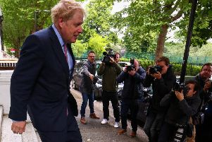 Boris Johnson faces the press pack as he leaves his home in south London. Picture: SWNS