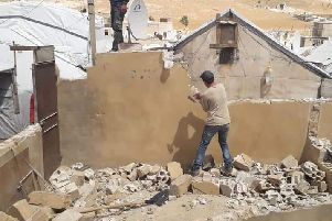 "Syrian refugees in the Arsal camp have been ordered to tear down their building over what the Lebanese authorities have called ""security risks"""