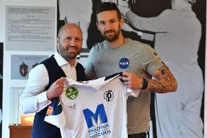 David Vanecek poses with his new shirt after joining Puskas Akademia. Pic: PFLA.hu