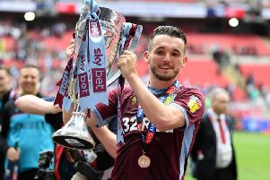 John McGinn celebrates Aston Villa winning promotion to the English Premier League