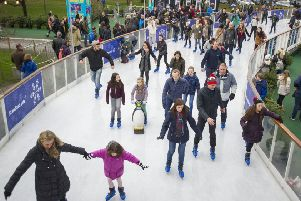 Families enjoys the ice rink in St Andrew Square. Picture: Ian Rutherford