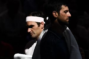Out of the shadows: Novak Djokovic wants to eclipse Roger Federer.  Picture: Anne-Christine Poujoulat/AFP/Getty Images