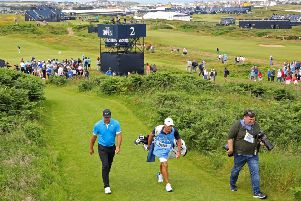 Brooks Koepka and his caddy Ricky Elliott during a practice round at Royal Portrush. Picture: Richard Sellers/PA Wire