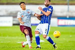 Hearts' Sean Clare battles for possession with Kris Renton.