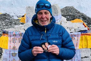Alan Sinclair, with a photo of his wife, at Everest base camp