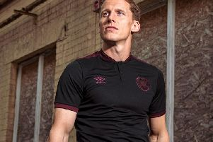 Christophe Berra modelling the new Heart of Midlothian third kit. Picture: SNS