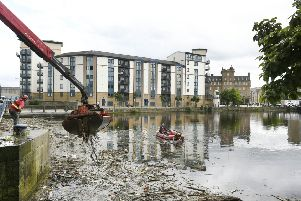 The litter squad has been deployed at Leith Shore to begin the clean-up operation. Picture: Neil Hanna