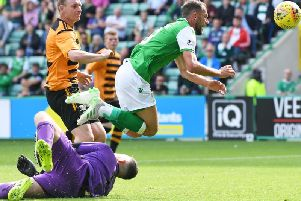 Neil Parry was injured trying to stop Christopher Doidge from opening the scoring for Hibs.